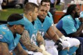Richie Incognito, second left, and Jonathan Martin, third left, on the bench during a recent game. Photo: AP