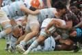 Racing Metro flanker Luc Barba is stopped by Toulouse No 8 Chris Tolofua in the Natixis Cup match at Aberdeen. Photo: Edward Wong