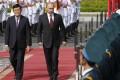 Russian President Vladimir Putin reviews a guard of honour with Vietnam President Truong Tan Sang in Hanoi. Photo: Reuters