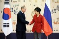 South Korean President Park Geun-hye and Russian counterpart Vladimir Putin in Seoul on Wednesday. Photo: EPA