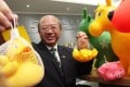 Professor Michael Hui King-man, chairman of the Consumer Council's publicity and community relations committee, displays toy samples containing extremely high levels of phthalates. Photo: KY Cheng