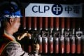 CLP Power and China Southern Power Grid sealed a deal to buy out Exxon Mobile's stake in the Castle Peak Power Company.