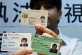 A Hong Kong born Pakistani man displays his identity cards. Ethnic minorities complain of racial profiling by police.