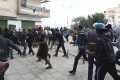 People flee from shooting during clashes between members of Islamist militant group Ansar al-Sharia and a Libyan army special forces unit in the Ras Obeida area in Benghazi on Monday. Photo: Reuters