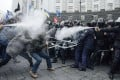 Protesters clash with riot police during a rally to support EU integration in central Kiev on Sunday. Photo: Reuters