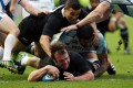 Andrew Hore scores for New Zealand in a clash with Scotland. He had 83 caps for the All Blacks. Photo: AFP