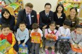 Credit Suisse Hong Kong's (back row, from left) Tiffany Chan, Neil Harvey, Peter Mo, Sarah Cheong and Nicole Yuen with children at the Watchdog Early Education Centre in Mid-Levels. Photo: Thomas Yau