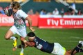 England's Sam Edgerley evades a tackle from Folau Niua of the USA during Friday's first day of action at the Dubai Sevens. Photo: AP