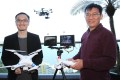 DJI Innovations founder Frank Wang Tao (left) shows off his products with his mentor Professor Li Zexiang. Photo: SCMP