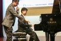 Singer-songwriter Antony Lun Wing-leung with budding composer Anson Wong Ying-Shun. Photo: SCMP