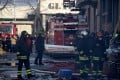Firefighters work at the scene of a deadly blaze at a Chinese-owned garment factory in Prato, Tuscany, at the weekend. Photo: EPA