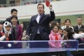British Prime Minister David Cameron plays table tennis with children in Chengdu. Photo: Reuters