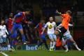Crystal Palace's Marouane Chamakh (left) scores against West Ham during their English Premier League match at Selhurst Park in London. Photo: Reuters