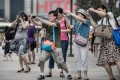 Tourists from mainland China on a visit to Hong Kong. Photo: AFP