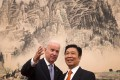 Joe Biden chats with Vice-President Li Yuanchao during his visit to Beijing. Photo: EPA