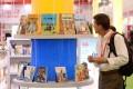 A visitor looks at a book exhibition at a Shanghai book fair. Photo: Xinhua