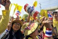 People wave flags to celebrate the Thailand's King Bhumibol Adulyadej's 86th birthday outside Klai Kangwon Palace, Khiri Khan province. Photo: Xinhua