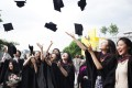 Students from the University of the Arts London celebrate after their graduation ceremony.
