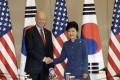 US Vice-President Joe Biden shakes hands with South Korean President Park Geun-hye in Seoul on Friday. Photo: AP