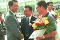 Bo Xilai (left) congratulates Wang Jianlin (centre) and coach Xu Genbao (right) on Wanda football club's championship win in 1998.