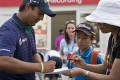 Shiv Kapur of India signs autographs after coming in joint second on the leaderboard at nine-under par going into the final day of the Hong Kong Open at Fanling. Photo: AFP