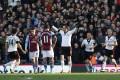 Fulham's Dimitar Berbatov (centre), celebrates his penalty goal against Aston Villa during their English Premier League match at Craven Cottage on Sunday. Photo: AP