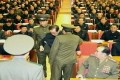 Kim Jong-un's uncle Jang Song-thaek is humiliatingly pulled from his chair by unformed officers at a meeting in Pyongyang. Photo: AFP