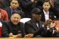 Kim Jong-un (left) and Dennis Rodman (right) watch North Korean and US players during an exhibition basketball game in Pyongyang in February. Photo: AP