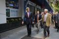 John Kerry walks through Ho Chi Minh City. Photo: Reuters