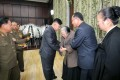 North Korean leader Kim Jong-un (centre left) meets with family of the late Kim Kuk Thae. Photo: AFP