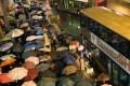 It was a sea of umbrellas outside Kwun Tong station as frustrated passengers waited for shuttle buses in the rain. Photo: SCMP