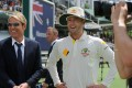 Hero of the Australian media Michael Clarke is joined by ex-player Shane Warne following Australia's Ashes win over England. Photo: AFP