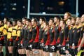 Belgium's players listen to their national anthem in the build-up to Tuesday's test match against Hong Kong. Photo: HKRFU