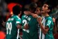 Raja Casablanca players celebrate Mouhssine Iajour's goal against Atletico Mineiro during their Club World Cup semi-final in Marrakech. Photos: Reuters