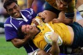 Samoa's Brian Lima gets to grips with Australia's Jeremy Paul in a test match in Sydney in 2005. Photo: Reuters