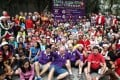 Hash runners are keen to get going as they gather before the start of the Operation Santa Claus Santa Hash 2013 at Lockhart Road playground in Wan Chai. Photo: Jonathan Wong