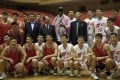 Former NBA basketball star Dennis Rodman poses with North Korean basketball players during a practice session in the North Korean capital Pyongyang. Photo: AP