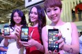 Promoters show off Huawei 4G phones. The mainland firm had been accused of violating 3G and 4G patents held by Philadelphia-based InterDigital. Photo: AFP