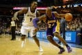 Lakers guard Kobe Bryant drives against Tony Allen during Tuesday's Memphis Grizzlies game in which he fractured his left knee. Photo: USA Today