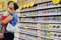 A Chinese woman selects milk powder for her child at a supermarket in Beijing. Photo: AFP