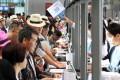 Passengers queue at the Kai Tak Cruise Terminal. Photo: Dickson Lee