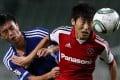 Tuen Mun's Yip Tsz-chun (left) levelled the scoring for his team, but Yokohama FC found the winner in injury time. Photo: Felix Wong