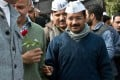 Arvind Kejriwal is given a rose in New Delhi yesterday. Photo: AFP