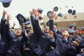 Cadets celebrate during a joint graduation ceremony of five military academies in Taipei. Photo: AFP