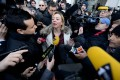 Michael Schumacher's manager, Sabine Khem, speaks to journalists in front of the Grenoble CHU hospital. Photo: AFP