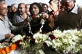 The mother (centre) of the rape victim cries as they offer floral tribute to her daughter. Photo: EPA