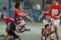 Hong Kong Select backrower Ron Siew offloads the ball during the match against the Overseas Barbarians at Hong Kong Football Club on New Year's Day. Photo: Dickson Lee
