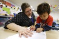 America's two-income households are facing a childcare crisis. Photo: AP