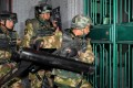Police pictured during the raid in Boshe village, Lufeng city, Guangdong. Photo: SCMP/Handout