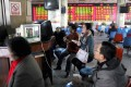 China shares fell during the first trading session of the year on Thursday, dragging down Hong Kong stocks, as investors worried about slower economic growth in China. Photo: Reuters